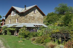 Oturehua, The Mill Bed and Breakfast.  In 1886, this former mill, constructed from locally quarried stone, was once used for grinding wheat grown in the Ida Valley.l