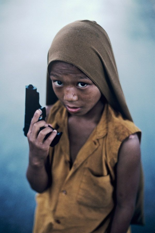 child soldier by Steve Mc Curry, his photography makes you think of things in the World. Reality can be very frightning,