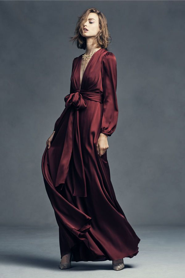 Oxblood Red Silk Bridesmaid Dress: Silk is always an elegant choice. This silk gown with billowing sleeves and plunging neckline is perfect for a glamorous evening wedding.