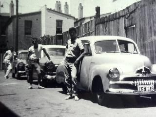 Ray Supple and his mates had no trouble finding parking spaces in Newtown for their beloved cars in 1962. Supplied by: Ray Supple
