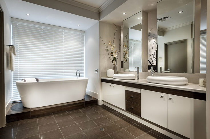 The Elise - I like the raised platform for the freestanding bath, the roofline and the way the cabinets appeared recessed.  TV would go in the kickout by the bath.
