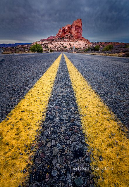 Road view towards a large monolith in Arches National Park, Utah photography landscape mountain #road