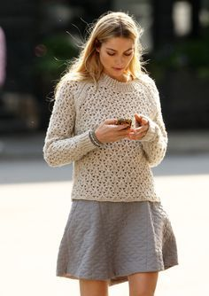 Style trick: Layer a knit sweater over a dress for the perfect transitional look.