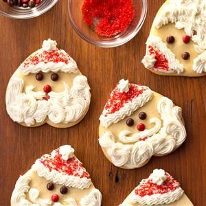 Santa Sugar Cookies Recipe -Ho ho ho! St. Nick can drop in any time when you bake these cute-as-can-be treats formed with a heart-shaped cookie cutter.—Jill Boruff, Soap Lake, Washington