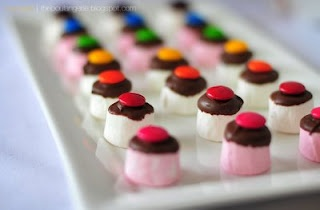dip marshmallows and top with  candy. cute!