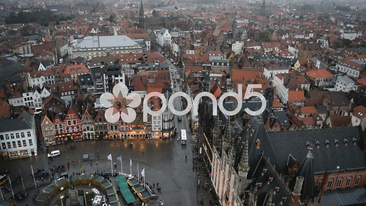 View from Belfry of Bruges. Markt Sq. buildings & restaurants. Bruges, Belgium - Stock Footage | by glenman77