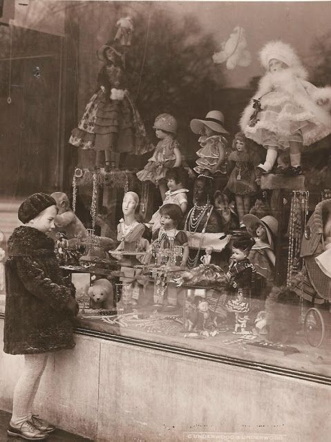 Doll shop window admirer, c.1920's
