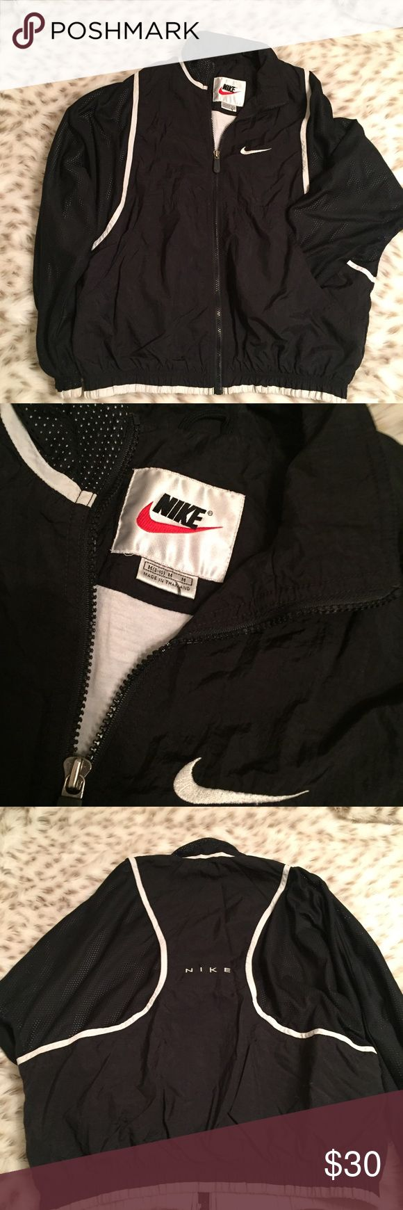 Vintage Nike Black and White Windbreaker Vintage Nike black and white Windbreaker! Size medium! Comfy and warm! Used but in great condition! Nike Jackets & Coats