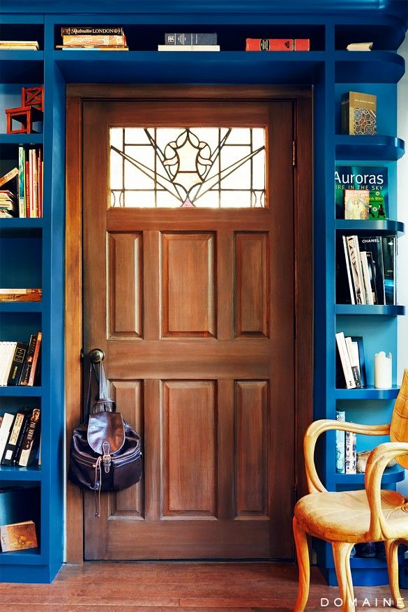The perfect deep ocean teal bookshelves around the door!! So good. Brings modern sensibility to a very traditional door. Inside Ian Harding's Handsome Canyon Hideaway via @domainehome
