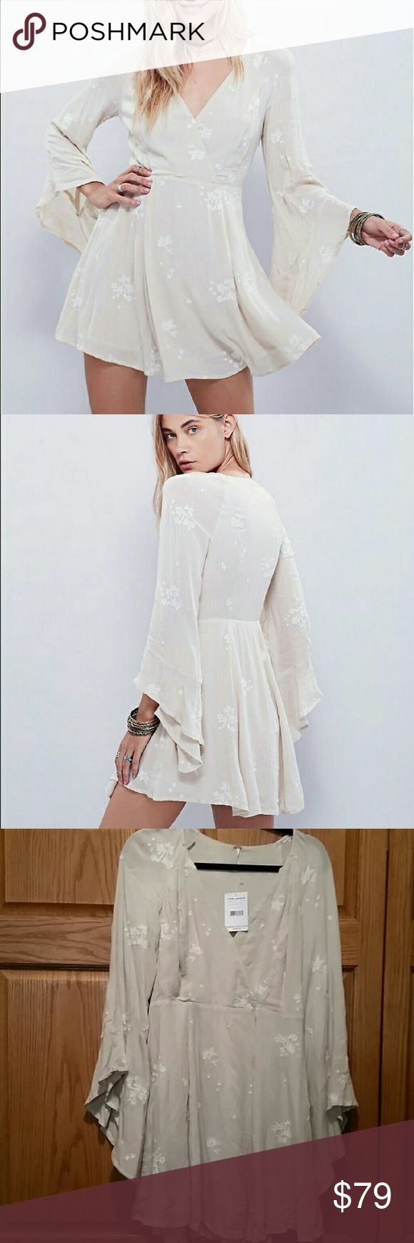 """NWT Free People Jasmine Embroidered Dress Free People Almond Combo Jasmine Embroidered Mini Dress, 65% rayon, 35% cotton, washable, 18"""" armpit to armpit (36"""" all around) 30"""" waist, 14"""" arm inseam before cuff that drapes down, 34"""" length, an airy mini dress with a flared skirt, flouncy angel sleeves, crossover V neckline, floral embroidery stitching detail throughout, concealed side zip closure, fully lined, (measurements are approx.) Gorgeous and flattering. Never worn, tags still attached…"""