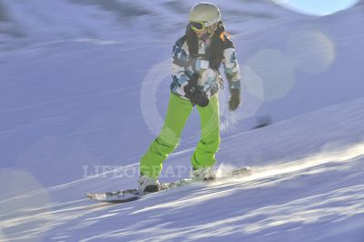 Young beautiful woman on the snowboard