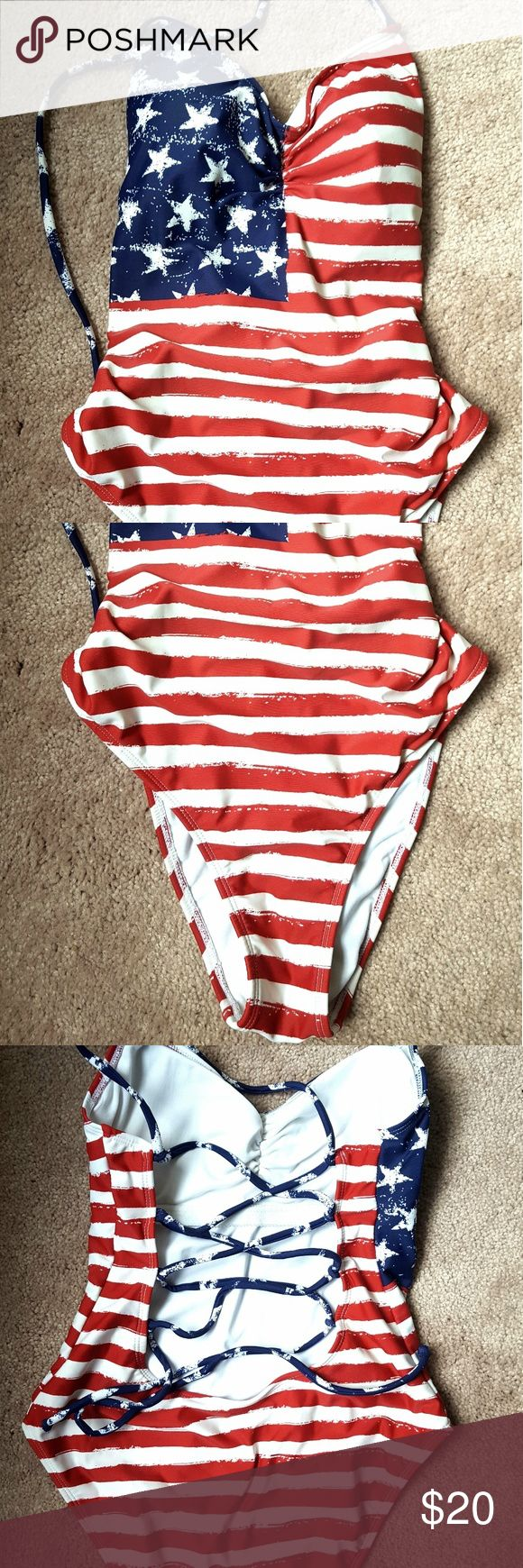 Great condition cute American flag swim suit Worn once in ocean so white stripes have slight yellowing. Otherwise in like new condition. Washed in tide and oxy. Size medium. Xhilaration Swim One Pieces