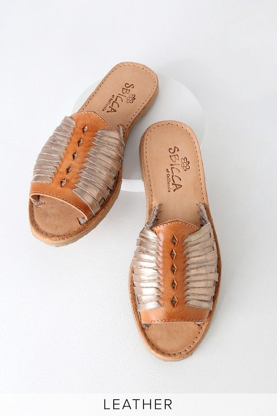 514b36a239e8 Woven genuine tan and rose gold leather forms these cute huarache style flat  sandals with top-stitched accents.