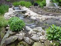 I love the look of water features in landscape design. I really like how big this stream is. I am planning on doing a little bit of work to my home, maybe I can put something like this in my yard.