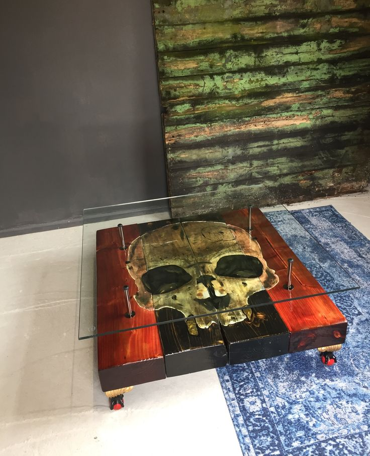 Gothic Skull Recalimed Coffee Table with glass top - A mysterious piece made from cheery red and black scottish sleepers, hand painted  ball & claw feet, black nickel supports and a piece of seamless toughend safety glass to finish.
