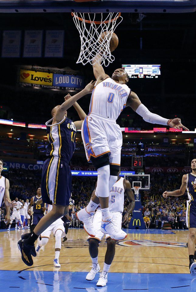 Oklahoma City's Russell Westbrook (0) goes up for a dunk in front of Utah's Dante Exum (11) during the NBA basketball game between the Oklahoma City Thunder and the Utah Jazz at the Chesapeake Energy Arena in Oklahoma City, Friday, Jan. 9, 2015. Photo by Sarah Phipps, The Oklahoman