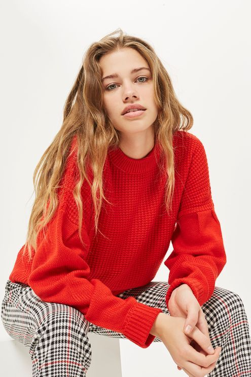 Channel an eighties-inspired look with our pleated sleeve jumper. In vibrant red, pair our modern design with mannish style trousers for a cool, casual look.
