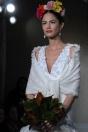 MAZING! If I was loaded! Frida Kahlo: Carolina Herrera: Bridal Spring 2011 | TheRingBearer.ca