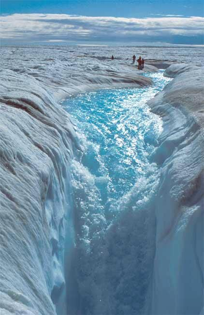 Jakobshavn Glacier: In the summer, increased temperatures cause melt ice to form lakes and rivers on the surface of the glacier. The water flows into deep vertical shafts in the ice called moulins. Scientists are unsure of where the water flow ends up, but it has been speculated that it may be falling to the base of the glacier. Water at the base of the glacier lubricates its motion and enhances its speed. It is believed that eventually the water drains into the the Arctic Sea.