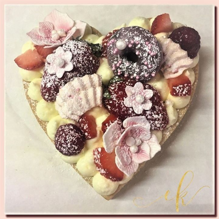 Almond Sable Vanilla Cream Tart with fresh fruit, meringue cookies, mini donuts, sugar flowers and showered with powder sugar. I am loving this new trend!