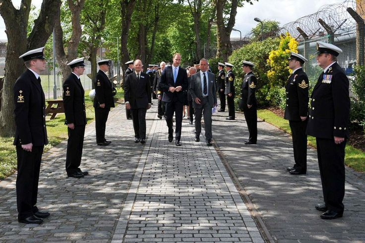 HRH #PrinceWilliam The Duke of Cambridge walks down the Royal Navy Submarine Museum's pathway #RoyalNavy #submarine #museum #Royalvisit #HMSAlliance
