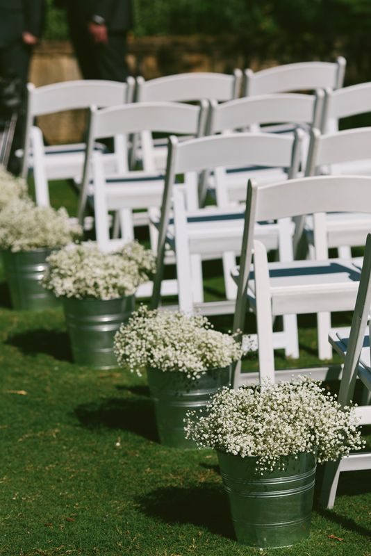 Wedding ceremony decorations. Flower buckets in the aisle. Image: Cavanagh Photography http://cavanaghphotography.com.au