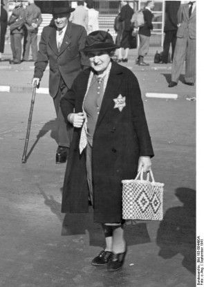 A woman wears the yellow Jewish star that the Nazis made compulsory from September 1941.