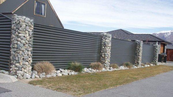 rock & tin fence