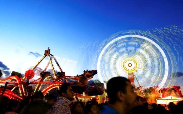People visit a fair during the festivities of El Divino Salvador del Mundo (The Divine Savior of the World), patron saint of the capital city of San Salvador, El Salvador.
