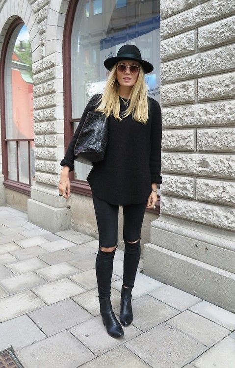 Studded black boots, ripped jeans, black knit