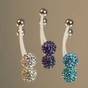 This site has amazing maternity belly button rings! They even have swarvoski crystal ones.