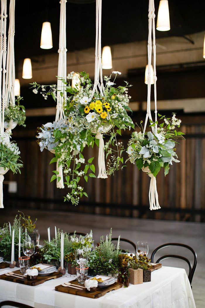 Borrowed from the 70's - Macramé hanging plant centerpieces. Credit: stylemepretty.com  McKenzie Powell Floral & Event Design #hangingcenterpieces #macrame