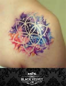 watercolor space tattoo, negative space flower tattoo