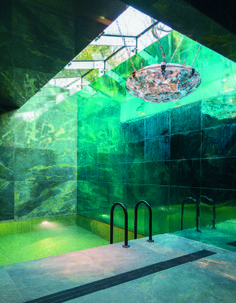 French architect, Annabel Karim Kassar's, design of a, green & blue granite tiled - interior swimming pool.