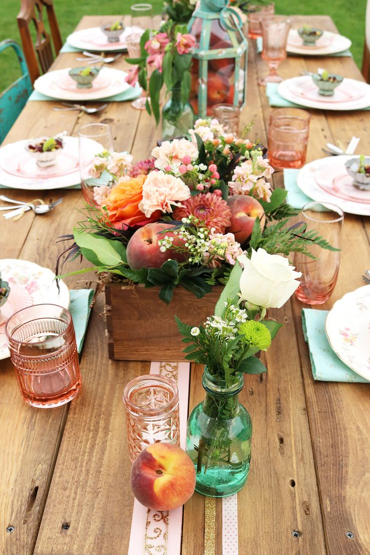 peach and flower #centerpiece @weddingchicks