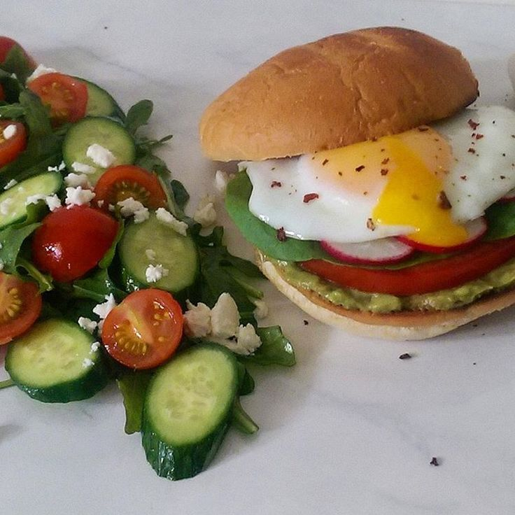 Happy #Humpday! #Lunchtime! Fresh guacamole, garden tomato, lettuce, radishes and a fried egg with ghost pepper flakes. Served with a deliciously fresh Greek salad with more tomatoes from the garden. Have a wonderful balance of your day! #sandwich @zimmysnook