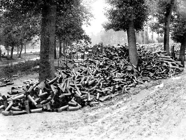 """""""Empty shell casings and ammunition boxes representing a small sample of the ammunition used by the British Army in the bombardment of Fricourt, France, on the first day of the Battle of the Somme, 1 July 1916."""" Australian War Memorial."""