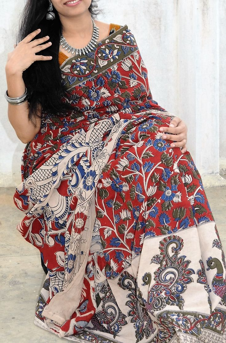 Pretty peacock kalamkari saree with floral designs