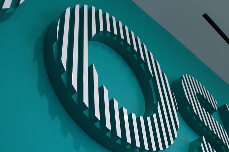 Dimensional letters from SharkNinja's HQ. Fabrication by DCL. Design by Sasaki. #dclbuilt #lettering #office #teal