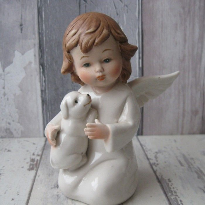 This is a beautifully detailed porcelain Angel. This ornament shows the scene of a playful Angel holding their pet puppy.   The Angel is finished in a lovely gloss glaze. This Angel is available for €12 on our website http://graangels.ie/angel-playing-with-puppy   This Angel is 13cm in height and 9cms in width.