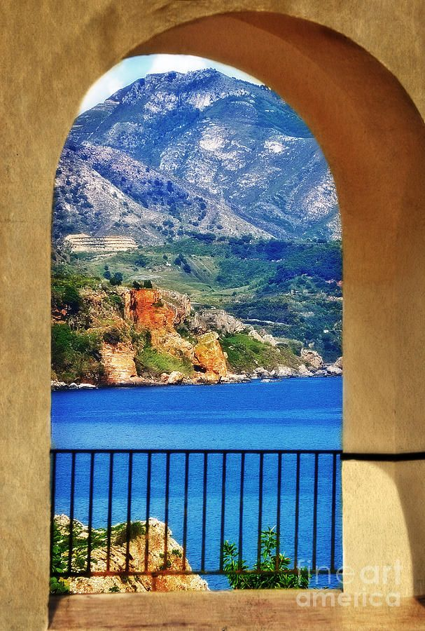 The Mediterranean Sea through a portico on the promenade in Nerja - Spain. Nerja is just 9 km from La Herradura. A pretty Spanish town that we visit with our students. Would you like to join us? www.spanish-school-herradura.com