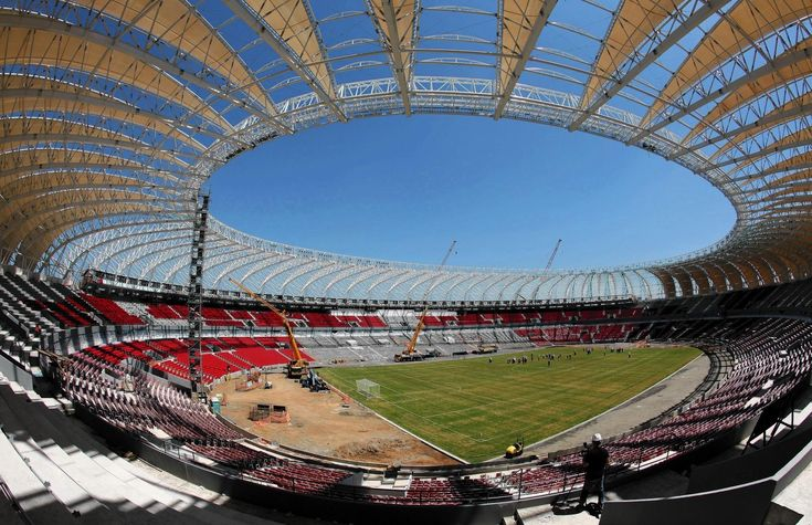 The soccer stadium in Porto Alegre, Brazil, is one of the venues for the 2014 World Cup. When Brazil agreed to host the sporting event in 12 cities, it hoped to use it as a stage to highlight its rising economic power. But many of the nation's planned infrastructure improvements have failed to materialize.
