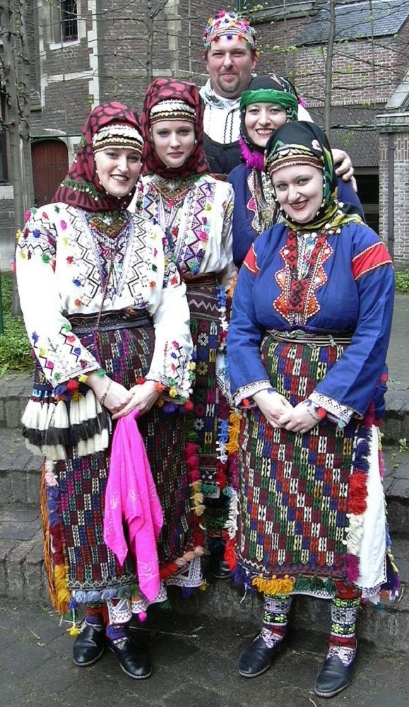 Traditional costumes from Nebiköy (15 km NE of Tokat city).  Style: 1960s.  Ethnic group: Alevi Türkmen.  The white dresses are festive, the blue ones are daily clothing. Both types of costume were still in use in the early 2000s.   (Kavak Costume Collection-Antwerpen/Belgium).