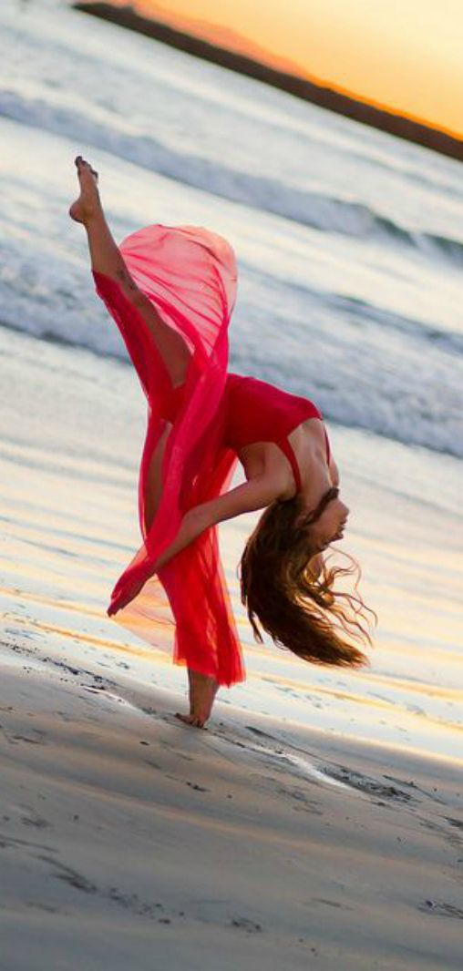 Sophia Lucia dancing on the beach. I love this dress. http://imgarcade.com/1/sophia-lucia-split-jump/ #dance #beaches