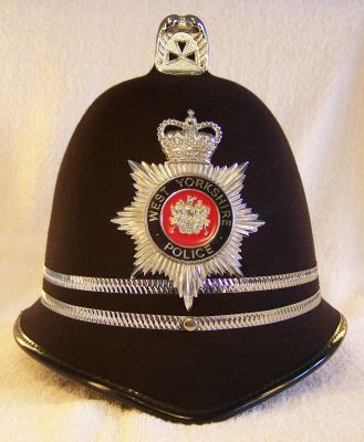 West Yorkshire Police, Inspectors Helmet 1980's  West Yorkshire Police, Inspectors Helmet 1980's, reinforced design with two thin chrome bands to denote rank, 'West Yorkshire Police' spelt in gold lettering