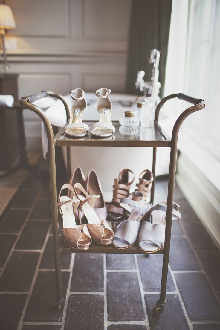Hostess Trolley of Shoes - On Love and Photography | Stylish City Wedding at The Hill Garden and Pergola, Hampstead Heath, London | Lace Self Portrait Wedding Dress
