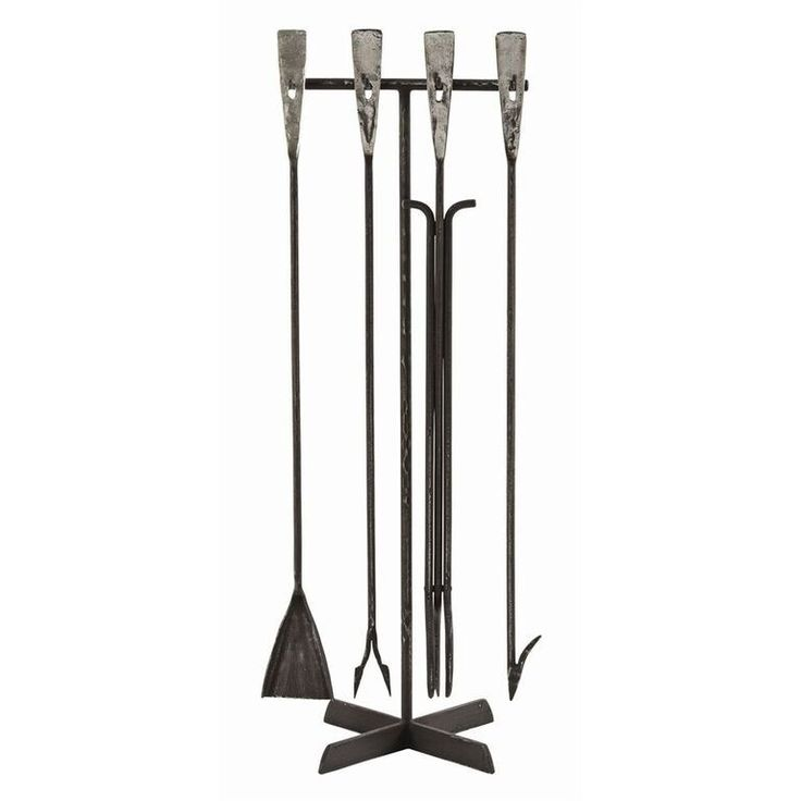 This hand forged iron tool set adds distinction to the hearth with a modern design created using old world craftsmanship and long-lasting materials. This tool set has polished handles that fit cleanly