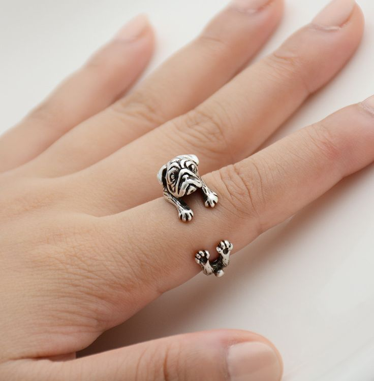 This ring is made in the shape of a pug that wraps around your finger. They are one size fits all and are plated in silver, bronze and black. This is perfect for anyone looking for unique cute animal