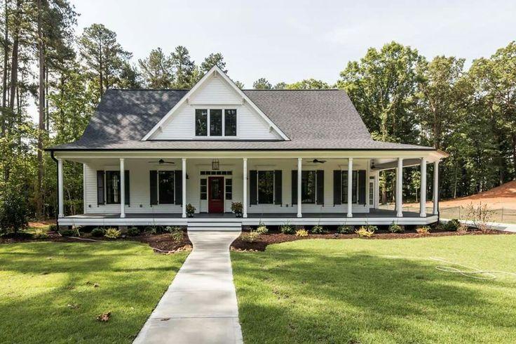 The Black and White Stonegate Farmhouse by Garman Homes