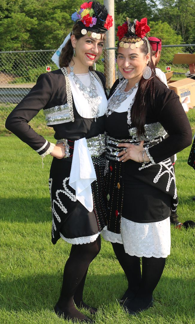 Two Hellenic Dancers in the traditional folk costumes of Roumlouki, Macedonia at the Catskills Greek Festival in Callicoon Center, New York.